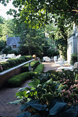 view [French Norman Manor House]: lower terrace, perennials and annual planting beds; boxwood hedges and seating areas. digital asset: [French Norman Manor House]: lower terrace, perennials and annual planting beds; boxwood hedges and seating areas.: 2007 Jun.