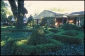 view [Eleanore Shulman Garden]: Topiary and boxwood hedges in front garden. digital asset: [Eleanore Shulman Garden]: Topiary and boxwood hedges in front garden.: 2010 Apr.