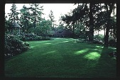 view [Stubblefield Garden]: facing east to house across main lawn from sculpture pool. digital asset: [Stubblefield Garden]: facing east to house across main lawn from sculpture pool.: 1995 May.