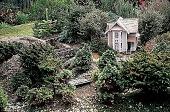 view [Hieronimus Garden]: train garden house, showing planting development. digital asset: [Hieronimus Garden]: train garden house, showing planting development.: 1998 Aug.