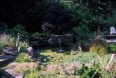 view [Jardin de mis Sueños]: pond with statuary (crane figures). digital asset: [Jardin de mis Sueños]: pond with statuary (crane figures).: 2006 Jul.