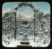 view [Breeze Hill]: Garden gate and entrance covered in snow. digital asset: [Breeze Hill] [lantern slide]: Garden gate and entrance covered in snow.