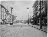 view [Miscellaneous Sites in Reading, Pennsylvania]: looking east from the 300 block of Penn Street toward 4th Street, showing the American House Hotel on the right and the Grand Central Hotel (1860) with its rooftop cupola/observatory in the left middle di... digital asset: [Miscellaneous Sites in Reading, Pennsylvania] [glass negative]: looking east from the 300 block of Penn Street toward 4th Street, showing the American House Hotel on the right and the Grand Central Hotel (1860) [...]