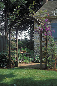 view [The Schoolhouse]: arbored entrance to back terrace. digital asset: [The Schoolhouse]: arbored entrance to back terrace.: 2002 May.