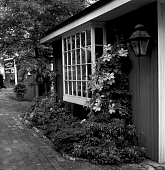 view [Peddler's Village]: plantings near entrance to village shops. digital asset: [Peddler's Village] [negative]: plantings near entrance to village shops.