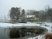 view [Tunnel Farm]: view of the main house from across the pond in winter. digital asset: [Tunnel Farm]: view of the main house from across the pond in winter.: 2008.