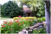 view [Blackwood]: beds of lilies and a three-tiered fountain outside of the music room where concerts are held. digital asset: [Blackwood]: beds of lilies and a three-tiered fountain outside of the music room where concerts are held.: 2012 Jun.