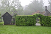 view [Foxlea]: the hornbeam arched hedge divides the lawn from the house and out buildings. digital asset: [Foxlea]: the hornbeam arched hedge divides the lawn from the house and out buildings.: 2013 May.