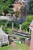 view [Garden Dreams Urban Farm and Nursery]: Vegetables growing in raised beds and seeding trays on re-used building materials. digital asset: [Garden Dreams Urban Farm and Nursery]: Vegetables growing in raised beds and seeding trays on re-used building materials.: 2014 Jun