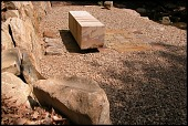 view [Longbow]: A cantilevered bench near the river with stone slabs and boulders set in gravel. digital asset: [Longbow]: A cantilevered bench near the river with stone slabs and boulders set in gravel.