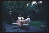 view [Rochambeau House]: family group at outdoor table. digital asset: [Rochambeau House]: family group at outdoor table.: 1952.