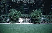 view [Rochambeau House]: terrace wall from south garden lawn; Mary Elizabeth Sharpe and garden bench. digital asset: [Rochambeau House]: terrace wall from south garden lawn; Mary Elizabeth Sharpe and garden bench.: 1952.
