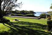 view [Wildacre]: the view toward the bocce court and wave topiary privet, looking past the cove to the ocean. digital asset: [Wildacre]: the view toward the bocce court and wave topiary privet, looking past the cove to the ocean.: 2013 Sep.