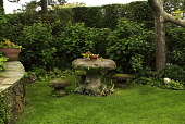 view [The Whim]: the mushroom table and stools are in a shady nook. digital asset: [The Whim]: the mushroom table and stools are in a shady nook.: 2009 Jun.