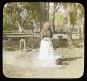 view Middleton Place: women stirring a kettle outside; possibly Annette Mayes, born a slave and lived as a free woman at Middleton Place until the 1930s. digital asset: Middleton Place: women stirring a kettle outside; possibly Annette Mayes, born a slave and lived as a free woman at Middleton Place until the 1930s.: [between 1914 and 1930s?]