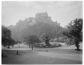view [Princes Street Gardens]: looking across the gardens toward Edinburgh Castle, with the Ross Fountain in the center of the image. digital asset: [Princes Street Gardens] [glass negative]: looking across the gardens toward Edinburgh Castle, with the Ross Fountain in the center of the image.