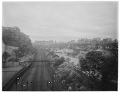 view [Princes Street Gardens]: looking west in the gardens, with Edinburgh Castle on the left. digital asset: [Princes Street Gardens] [glass negative]: looking west in the gardens, with Edinburgh Castle on the left.
