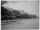 view [Princes Street Gardens]: a colorful border in the gardens with Edinburgh Castle in the background. digital asset: [Princes Street Gardens] [glass negative]: a colorful border in the gardens with Edinburgh Castle in the background.