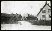 view [Garden City Estates]: a group of houses on Ridge Road, Birds Hill, in Letchworth Garden City. digital asset: [Garden City Estates] [lantern slide]: a group of houses on Ridge Road, Birds Hill, in Letchworth Garden City.