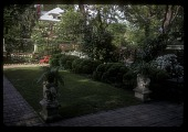 view [Moore Garden]: small rectangular lawn at the rear of the house. digital asset: [Moore Garden] [slide]: small rectangular lawn at the rear of the house.