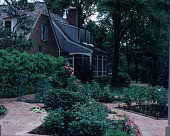 view [Michael McDonnell Garden]: house facing northeast. digital asset: [Michael McDonnell Garden]: house facing northeast.: 1987 May.