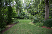 view [The Craighead House and Garden]: a passageway from one garden to another, withsome antique bricks in the border. digital asset: [The Craighead House and Garden]: a passageway from one garden to another, withsome antique bricks in the border.: 2013 Aug.