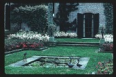 view [Dogwoods]: facing south from the clock garden, looking toward the rear of the house, showing the ornamental pool, parterres, and terraced lawn. digital asset: [Dogwoods]: facing south from the clock garden, looking toward the rear of the house, showing the ornamental pool, parterres, and terraced lawn.: 1986.