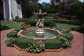 view [Ravenwood]: fountain and formal plantings in front of main entrance to house. digital asset: [Ravenwood]: fountain and formal plantings in front of main entrance to house.: 1999 Aug.
