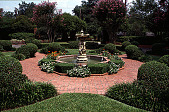 view [Ravenwood]: fountain and formal plantings, including crape myrtle, in front of main entrance to house. digital asset: [Ravenwood]: fountain and formal plantings, including crape myrtle, in front of main entrance to house.: 1999 Aug.