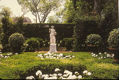 view [Holly Cottage Garden]: female sculpture, hedges, and white geraniums in front of tall hedge. digital asset: [Holly Cottage Garden]: female sculpture, hedges, and white geraniums in front of tall hedge.: 2005 May.