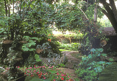 view [Gibson Garden]: Oaklawn Garden from French urn/impatiens bed with wings and herb bed in Open Garden. digital asset: [Gibson Garden]: Oaklawn Garden from French urn/impatiens bed with wings and herb bed in Open Garden.: 2003.