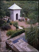 view [David-Peese Garden]: Lower patio with retaining walls, dovecote, which began as a toolshed. digital asset: [David-Peese Garden] [transparency]: Lower patio with retaining walls, dovecote, which began as a toolshed.