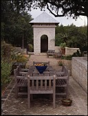 view [David-Peese Garden]: Terrace shaded by live oak trees, leading to a limestone pavilion with a dovecote. digital asset: [David-Peese Garden] [transparency]: Terrace shaded by live oak trees, leading to a limestone pavilion with a dovecote.