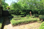 view [Birdwell Garden]: one of the parterres has planted containers and a statue of a boy with a shell in the center. digital asset: [Birdwell Garden]: one of the parterres has planted containers and a statue of a boy with a shell in the center.: 2015 Apr.