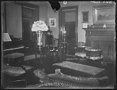 view [Grafton Hall]: an interior view of the house, showing a leopard-skin rug. digital asset: [Grafton Hall] [glass negative]: an interior view of the house, showing a leopard-skin rug.