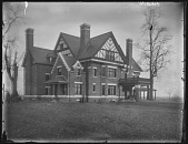 view [Grafton Hall]: a view of the brick house, showing its half-timber gables and three chimneys. digital asset: [Grafton Hall] [glass negative]: a view of the brick house, showing its half-timber gables and three chimneys.
