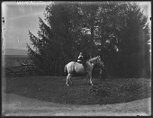 view [Miscellaneous Images in Virginia]: boy leading a girl on a horse at an unidentified location. digital asset: [Miscellaneous Images in Virginia] [glass negative]: boy leading a girl on a horse at an unidentified location.