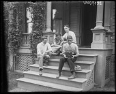 view [Miscellaneous Images in Virginia]: four unidentified teenage boys on steps with camera in an unidentified location. digital asset: [Miscellaneous Images in Virginia] [glass negative]: four unidentified teenage boys on steps with camera in an unidentified location.