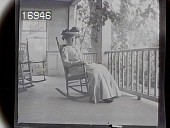 view [Miscellaneous Images in Virginia]: an unidentified woman sitting in a rocking chair on a porch. digital asset: [Miscellaneous Images in Virginia] [nitrate negative]: an unidentified woman sitting in a rocking chair on a porch.