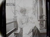 view [Miscellaneous Images in Virginia]: an unidentified woman with a baby sitting on a porch. digital asset: [Miscellaneous Images in Virginia] [nitrate negative]: an unidentified woman with a baby sitting on a porch.