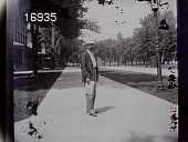 view [Miscellaneous Images in Virginia]: an unidentified man standing on a sidewalk. digital asset: [Miscellaneous Images in Virginia] [nitrate negative]: an unidentified man standing on a sidewalk.
