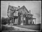 view [Pelham]: Gothic-style house with long wooden porch. digital asset: [Pelham] [glass negative]: Gothic-style house with long wooden porch.