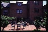view [Douthat Garden]: brick patio with garden furniture. digital asset: [Douthat Garden]: brick patio with garden furniture.: 1998 June 3.