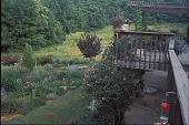 view [A Country Garden]: view from deck of meadow, garden, and cutting gardens. digital asset: [A Country Garden]: view from deck of meadow, garden, and cutting gardens.: 2002 Jul.