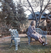 view [Warrenton Country School]: a student dressed as the mascot Le Capuchon sitting on the ornamental grape setee in Autumn. digital asset: [Warrenton Country School]: a student dressed as the mascot Le Capuchon sitting on the ornamental grape setee in Autumn.: [between 1915 and 1950]