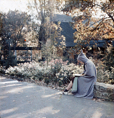 view [Warrenton Country School]: a student wearing le capuchon, the French school uniform cloak. digital asset: [Warrenton Country School]: a student wearing le capuchon, the French school uniform cloak.: [between 1915 and 1950]