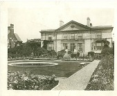 view [The Merrill House]: circular pool in square lawn with house in background. digital asset: [The Merrill House]: circular pool in square lawn with house in background.: 1928.