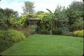 view [Froggy Bottom]: gateway garden and lawn inside gated entrance. digital asset: [Froggy Bottom]: gateway garden and lawn inside gated entrance.: 2005 Apr.