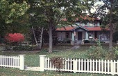 view [Tatterdemalion]: a front view of the arts and crafts style lake cottage. digital asset: [Tatterdemalion]: a front view of the arts and crafts style lake cottage.: 1998 Oct.