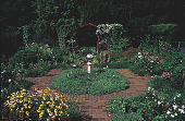 view [Flowerside Inn]: assorted annual and perennial flowers with herbs in the center section. digital asset: [Flowerside Inn]: assorted annual and perennial flowers with herbs in the center section.: 1999.